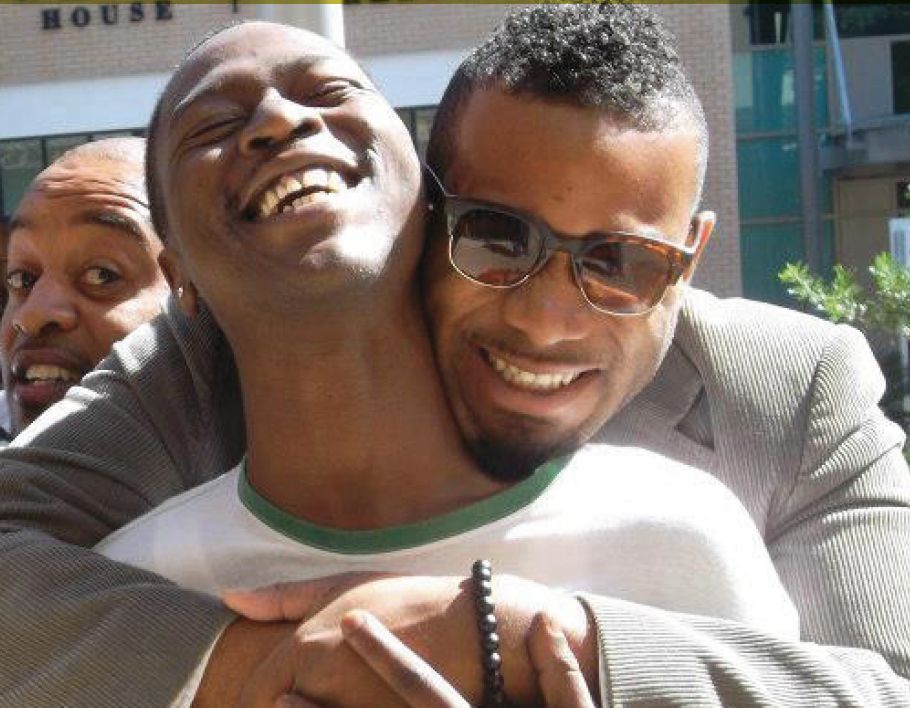 Photo of two black men hugging
